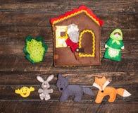 Handmade felt toys over wooden rustic background. Felt toys stor Royalty Free Stock Images