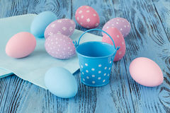 Handmade festive easter eggs on blue background Stock Photos