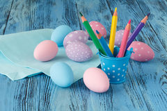 Handmade festive easter eggs on blue background Royalty Free Stock Photography