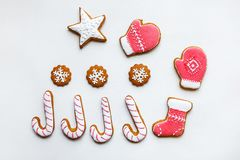 Handmade festive gingerbread cookies in the form of stars, snowflakes, people, socks, staff, mittens, Christmas trees, hearts for royalty free stock photography