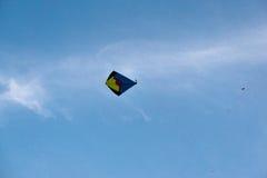 Handmade fighting kites flying against blue sky Stock Photography