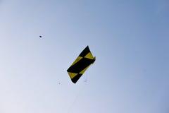 Handmade fighting kites flying against blue sky Royalty Free Stock Photos