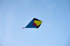 Handmade fighting kites flying against blue sky Stock Images