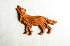 Handmade Figurine made of clay, plasticine on a wooden backgroun Royalty Free Stock Photography