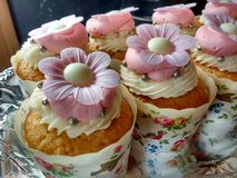 Handmade floral decorated cupcakes. Tray of handmade floral decorated cupcakes Stock Photo