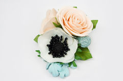 Handmade flower fabric foamiran. Artificial flowers made from sp Royalty Free Stock Photos
