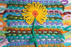 Handmade flower knitted wool colorful texture background Stock Image