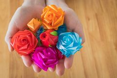 Handmade flower ribbons.wrap a coin inside for donation in Thai` stock photography