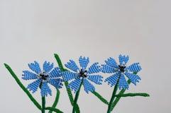 Handmade flowers. Three handmade flowers on white background stock photos