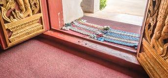 Handmade foot scraper on the floor Stock Photo