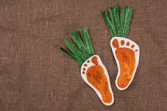 Handmade foot-shaped carrot Stock Images