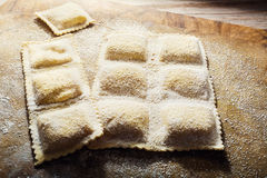 Handmade fresh ravioli. On rustic wood background Royalty Free Stock Photo