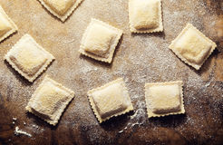 Handmade fresh ravioli. On rustic wood background Royalty Free Stock Photography