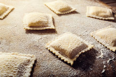 Handmade fresh ravioli. On rustic wood background Stock Photography