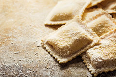 Handmade fresh ravioli. On rustic wood background Stock Images