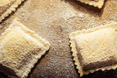 Handmade fresh ravioli. On rustic wood background Royalty Free Stock Images