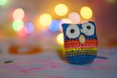 Handmade From Wool Bound Owl On Festive Background Bokeh Against Lamps Stock Photography