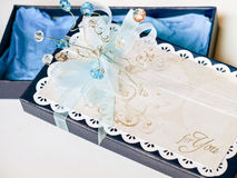 Handmade gift box decorated with blue and white gems, white lace and stamped paper Stock Photos