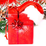 Handmade gift box with Santa hat in a snow covered Royalty Free Stock Photo