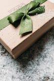 Handmade gift box in snow. christmas gift Royalty Free Stock Photo