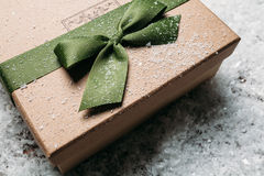 Handmade gift box in snow. christmas gift Royalty Free Stock Images