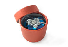 Handmade gift box with surprise in it. Handmade round red gift box with surprise in it: blue little box with rag flower Stock Photos