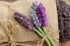 Handmade gift, knitted lavender flower Stock Images