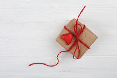 Handmade gift wrapped in kraft paper with red heart Royalty Free Stock Image