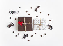 Handmade gifts on white background decorated with heart and paper serpentine. Top view, flat lay Royalty Free Stock Photos