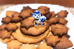 Handmade ginger cookies with toy ceramic sheep on the top. On the  plate Stock Images