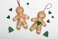 Handmade gingerbread men and green hearts on a white background and the words love love stock photo