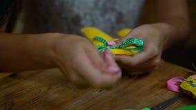 Handmade girls sewing letters of felt stock video
