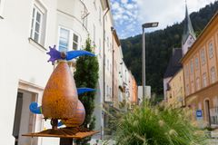 Handmade glass in different shapes, forms decorating the town in. RATTENBERG, AUSTRIA - SEPTEMBER 2017 : Handmade glass in different shapes, forms decorating the Stock Images