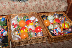 Handmade glass globes. Placed in wicker baskets Stock Image