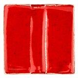 Handmade glazed red ceramic tile Stock Image