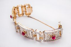 Gold and silver Bracelet with red rubies stock photos