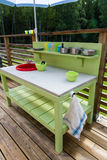Handmade kitchen for a child to play with. Handmade green kitchen for a child to play with Stock Photos