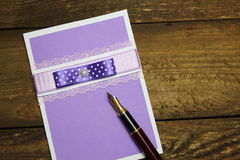 Handmade greeting cards and pen Stock Images