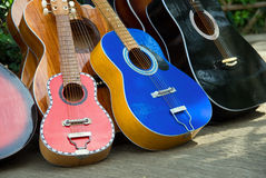 Handmade guitars on street sale. A series of colorful Cebu handmade and manually crafted painted guitars - of various sizes - aligned outdoors in Cebu City ( Stock Image