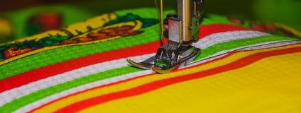 Handmade. hand sewing. Machine stitch, hand sewing.the machine sews on fabric Stock Image