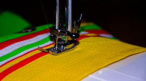 Handmade. hand sewing. Machine stitch, hand sewing.the machine sews on fabric Stock Images