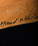 Handmade. Hand written on wood Royalty Free Stock Image