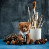 Handmade toy teddy bear brown plush pine cones. Handmade handcrafted toy teddy bear brown plush pine cones plush retro doll furry toy cute adorable with Stock Image