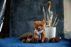 Handmade toy teddy bear brown plush pine cones Royalty Free Stock Photo
