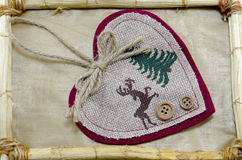 Handmade heart embroidery in a bamboo frame Stock Images