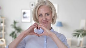 Handmade Heart by Emotional Old Woman. 4k high quality, 4k high quality stock footage