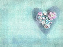 Handmade heart on grunge turquoise background. Royalty Free Stock Image