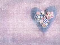 Handmade heart on grunge violet background. Royalty Free Stock Photo