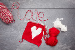 Handmade heart knitted made from yarn with word love Stock Photos