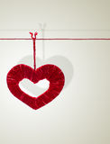 Handmade heart made from red threads Stock Images
